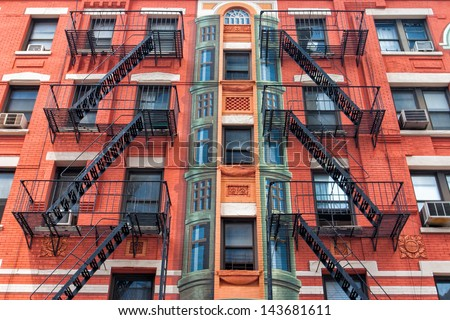 The typical old houses with fire stairs in New York in USA