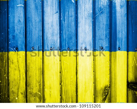 The Ukrainian flag painted on wooden fence - stock photo