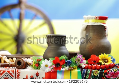 the Ukrainian ware against the Ukrainian flag - stock photo