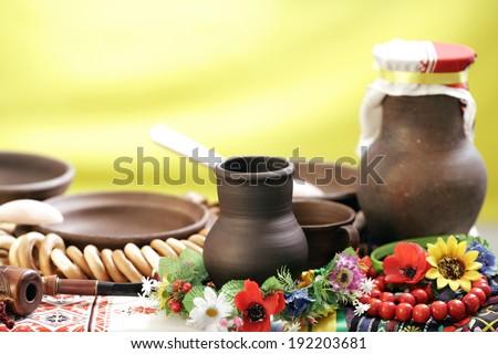 the Ukrainian ware against the Ukrainian flag - stock photo