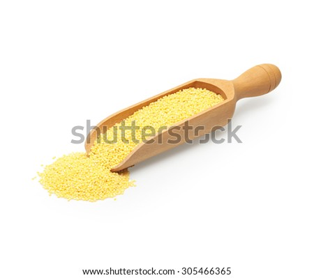 the uncooked millet in wooden scoop, isolated on a white - stock photo