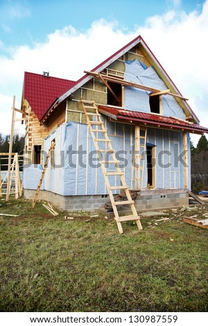 The under construction wooden house autumn
