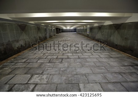 The underground passage lined with gray granite and marble - stock photo