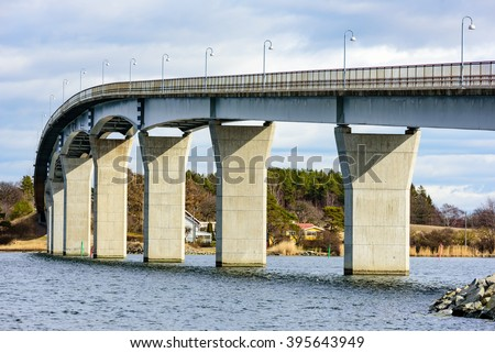 The underside of the Senoren bridge in the Blekinge archipelago of Sweden. Sun is shining on the pillars.