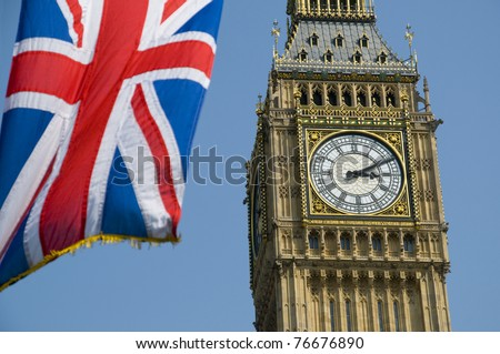 The Union Flag flying in front of the clock tower, commonly referred to as Big Ben, of the Palace of Westminster. - stock photo