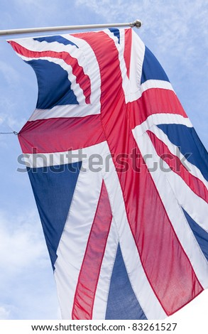 The Union Flag of the United Kingdom against a bright blue background - stock photo