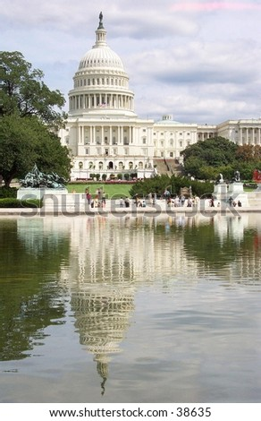 The United States Capitol Building and reflecting pool. - stock photo