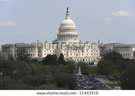 The United States Capitol building viewed looking down Pennsylvania Avenue. - stock photo
