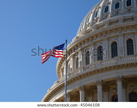 The United States Capitol dome and flag in Washington DC. - stock photo
