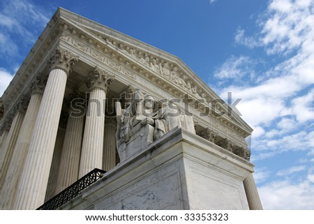 The United States Supreme Court from a low angle. - stock photo