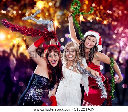 the unlike trio 06/Devil, Angel and Santa dancing in the disco - stock photo