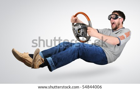 The unreal mad man in goggles with a wheel in hands - stock photo