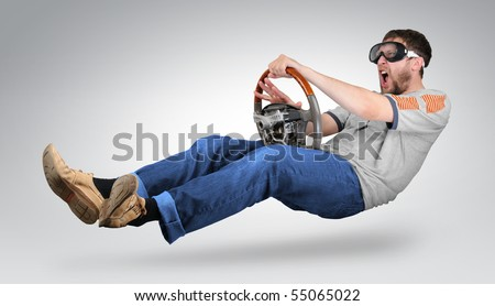 The unreal mad man in goggles with a wheel in hands signals - stock photo