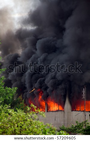The upper floor of the building on fire. - stock photo