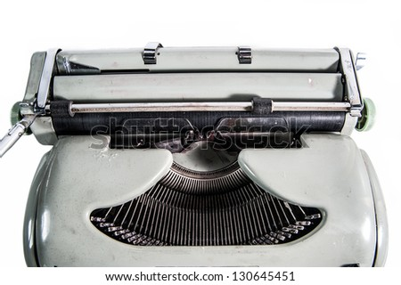 The upper fragment of the typewriter on white background - stock photo