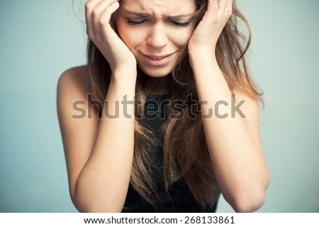 The upset woman loudly cries. - stock photo