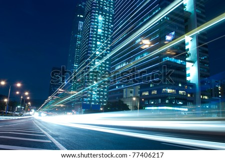 The urban landscape at night and through the city traffic - stock photo