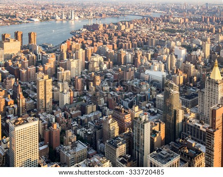 The urban landscape of New York City with the East River on the background - stock photo