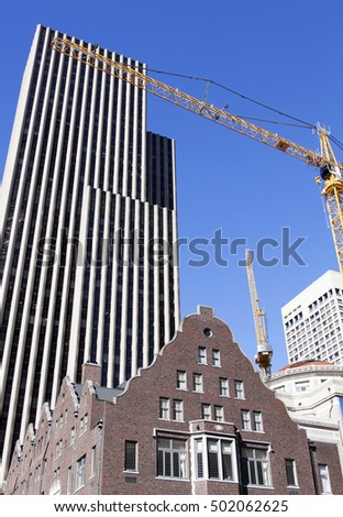 The urban view of different kind of buildings and cranes in Seattle downtown (Washington)