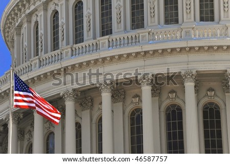 The US Capitol and US flag close up - stock photo
