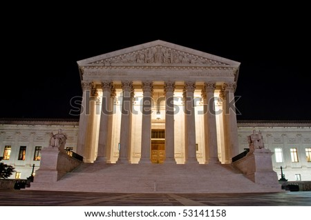 The US Supreme Court building at night in horizontal - stock photo