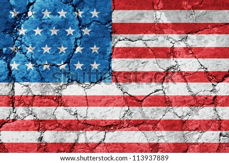 The USA flag painted on cracked ground - stock photo