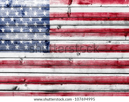 The USA flag painted on wooden fence - stock photo