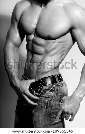 The uscular male body  on white background. - stock photo