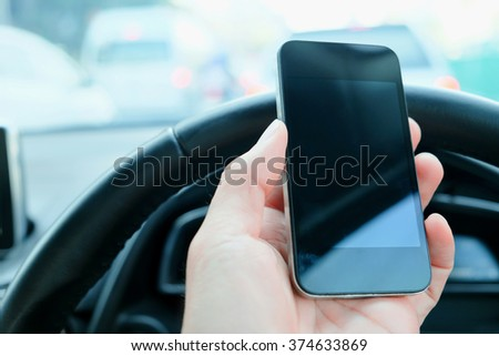 The use of mobile phones in the car and the traffic jam on the outside. urban lifestyle and communication technology concept. - stock photo