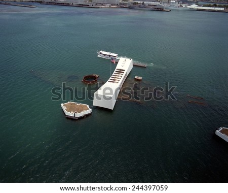 The USS ARIZONA Memorial in Pearl Harbor. The actual battleship sunk during Japanese attack on Pearl Harbor on December 7 1941 is visible directly beneath memorial. June 1 1991. - stock photo