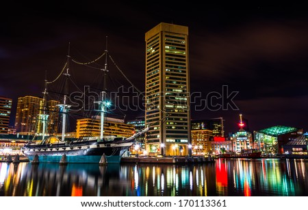 The USS Constellation and World Trade Center at night, in the Inner Harbor of Baltimore, Maryland. - stock photo