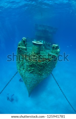 The USS Kittewake, a former submarine rescue vessel, was sunk in early 2011 in Grand Cayman to become an artificial reef and scuba diving attraction. - stock photo