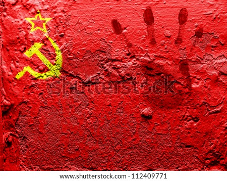 The USSR flag painted on grunge wall with bloody palmprint over it - stock photo