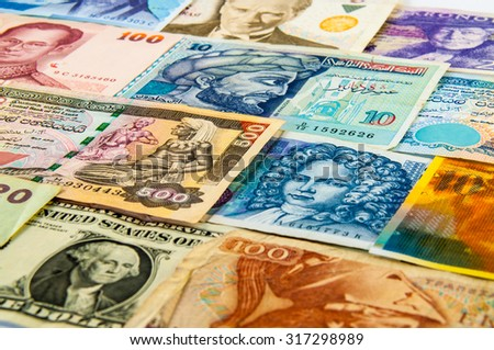 The variety Portraits on faces of international banknotes - stock photo