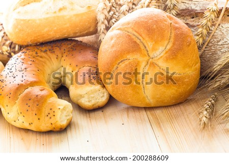 The various bakery products on wooden background - stock photo