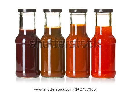 the various barbecue sauces in glass bottles - stock photo
