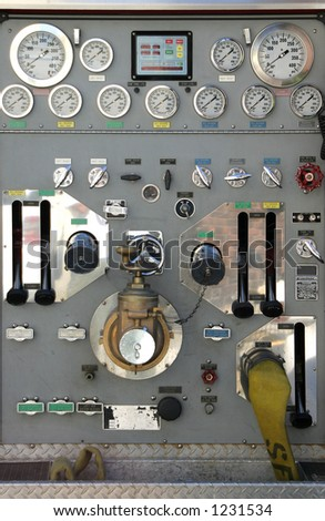 The various dials, knobs, and switches of a modern fire truck.