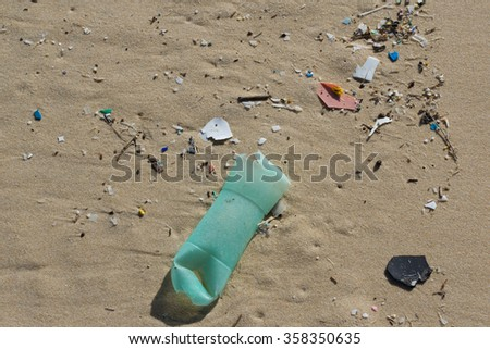 The Various garbage on the beach at summertime - stock photo