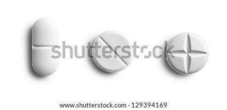 the various pills on white background - stock photo