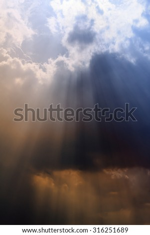 The vast blue sky and clouds sky with beautiful rays of sun.  - stock photo