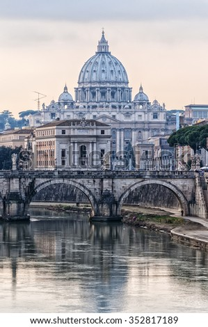 The Vatican's basilica of Saint Peter at dusk reflecting on the river tiber situated in the Italian capital of Rome. - stock photo