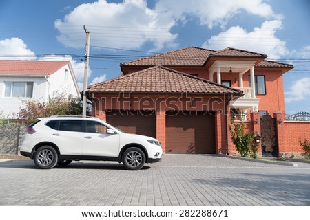 the vehicle is near the house - stock photo