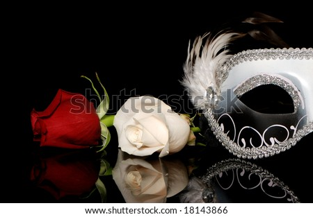 The Venetian mask and flowers on a black background - stock photo