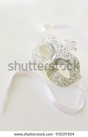 The Venetian mask on a light background - stock photo