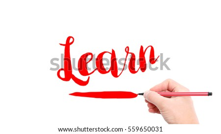 The verb Learn written on a white background