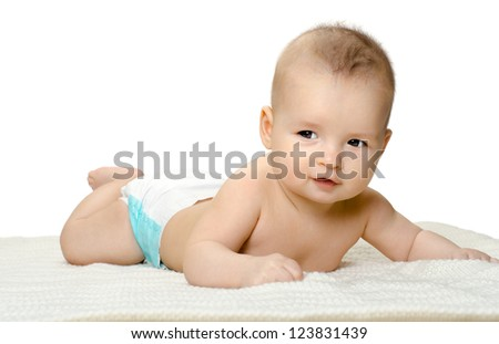 the very  beautiful  little baby , lie on stomach and crawl,  on white background, isolated - stock photo