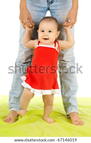 the very  beautiful  little kid , learn  walk with mother,  on white background, isolated - stock photo