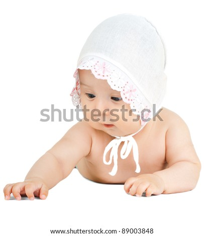 the very  beautiful  little kid , lie on stomach, seize and  look over anything, on white background, isolated - stock photo