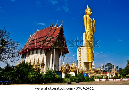 The very large standing golden Buddha, Thailand's Northeast. - stock photo
