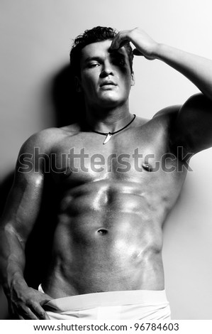 the very muscular  undressed handsome sexy guy,  black-and-white photo